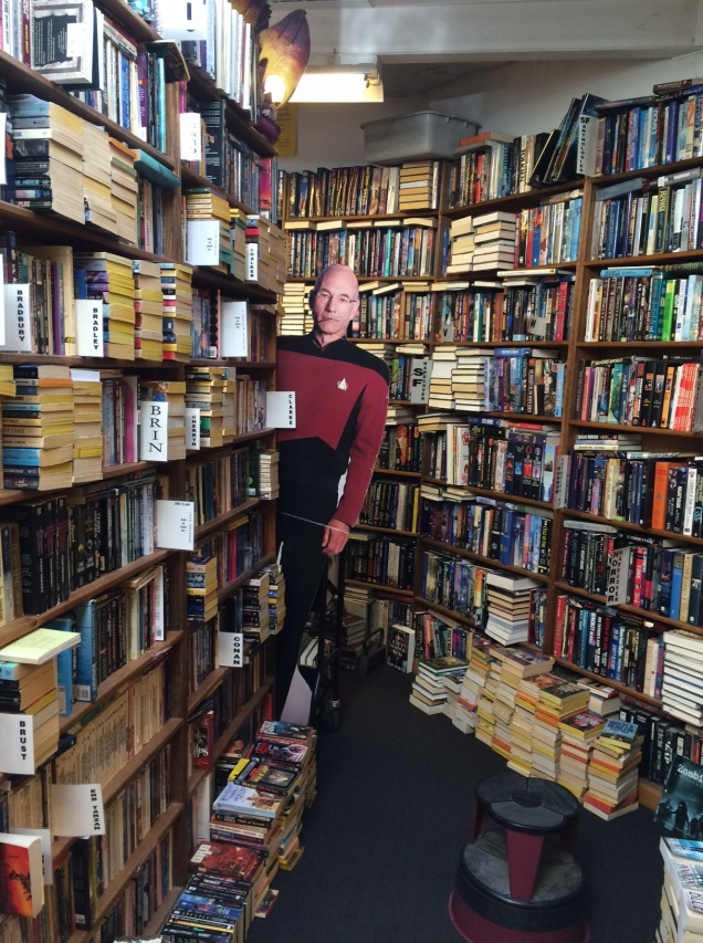 Picard keeping watch over Sci Fi at Dawn Treader's. Or is he beckoning me to join him in his quarters?