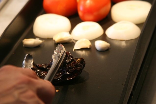 Three kinds of dried chiles get toasted before being soaked in water.