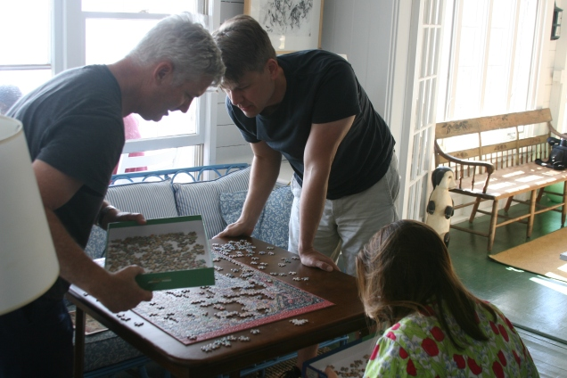 Puzzling with John's brother and his fiancee.